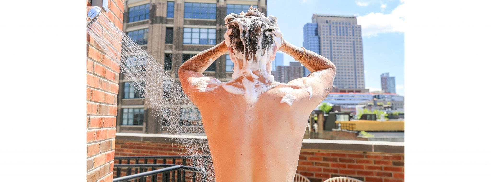Man showering outdoors on rooftop