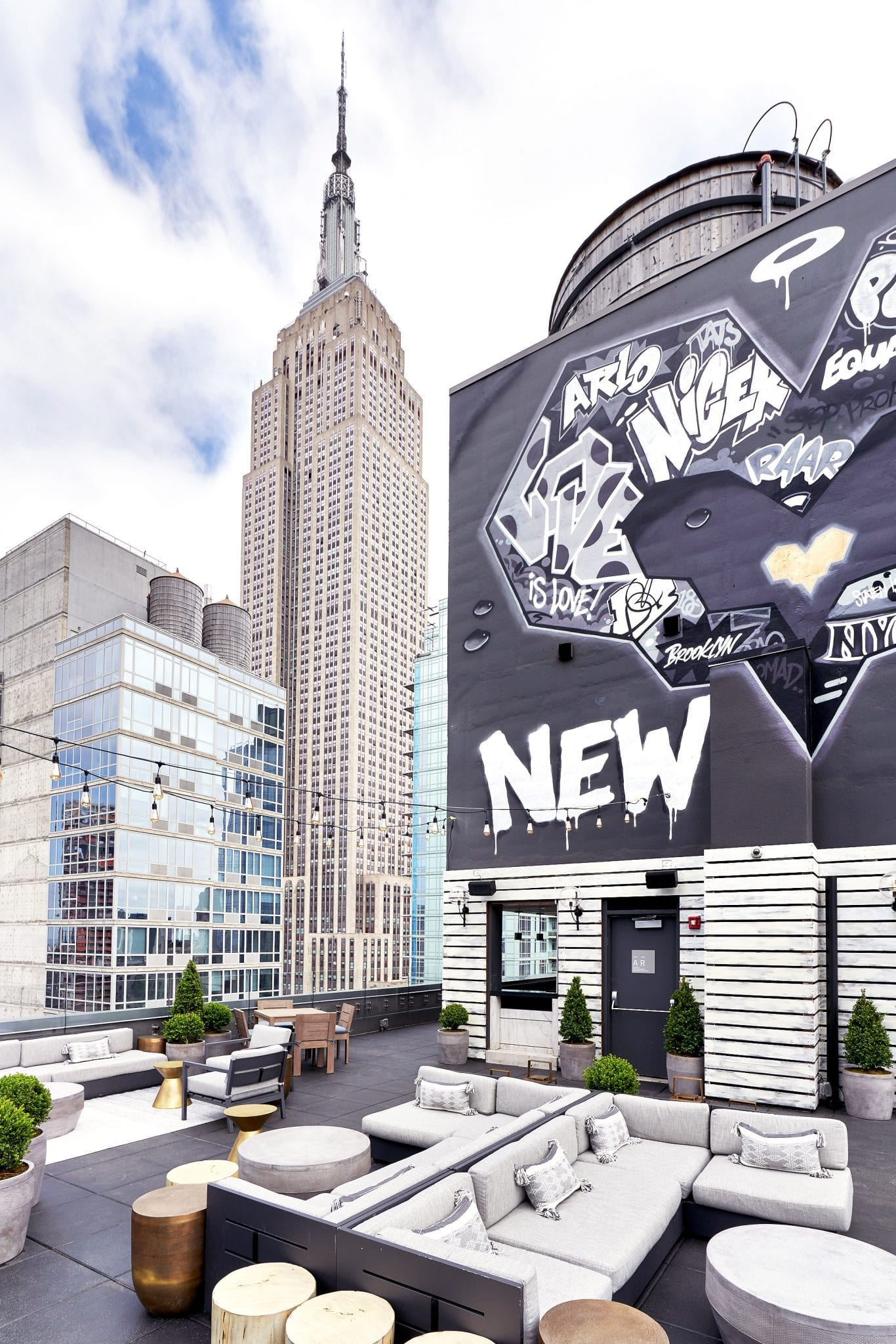 A.R.T. NoMad NYC rooftop with view of empire state building and mural