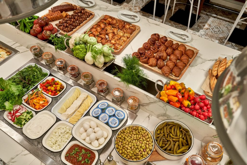 Lamalo Restaurant buffet food display with assorted vegetables pastries eggs and dips