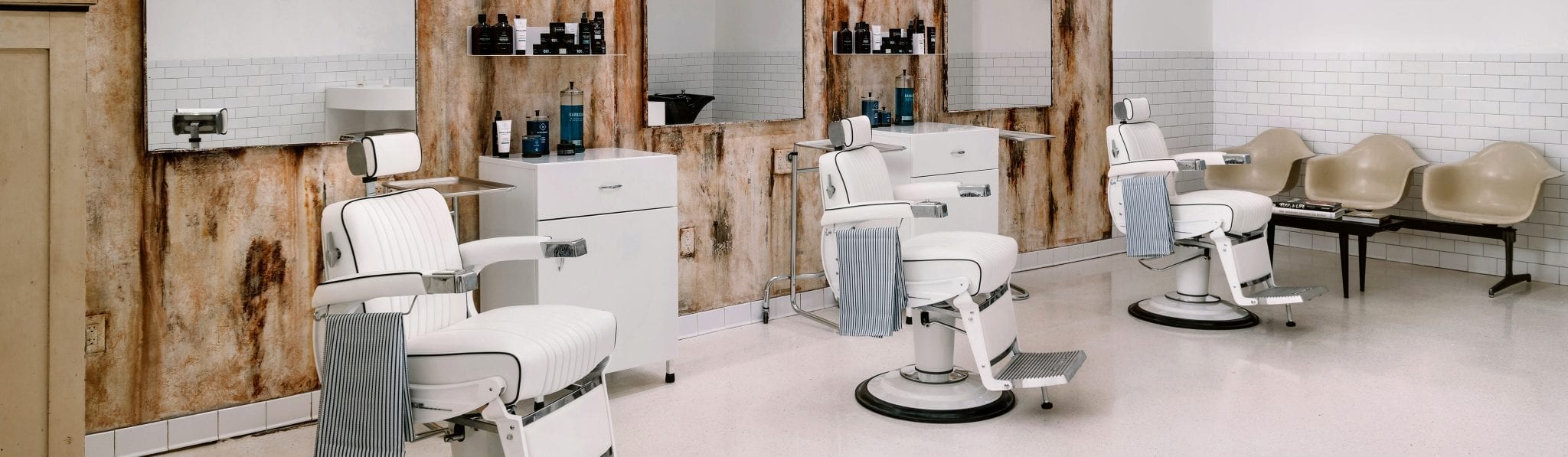 Blind Barber shop with white chairs