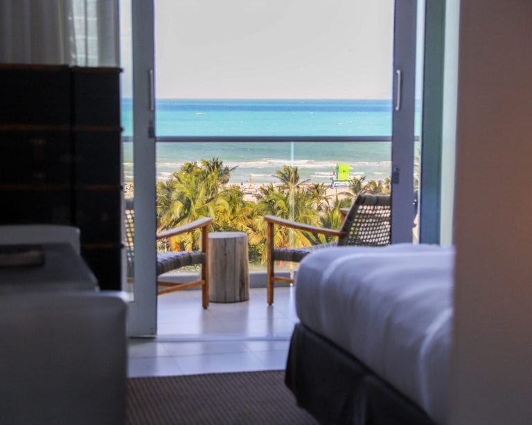 Hotel guestroom view of balcony terrace and beach
