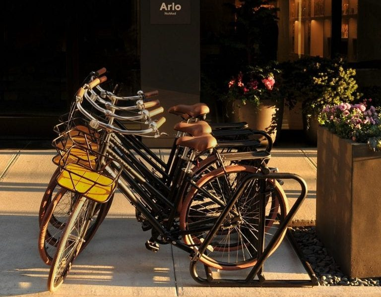 4 bikes on bike rack outside Arlo NoMad