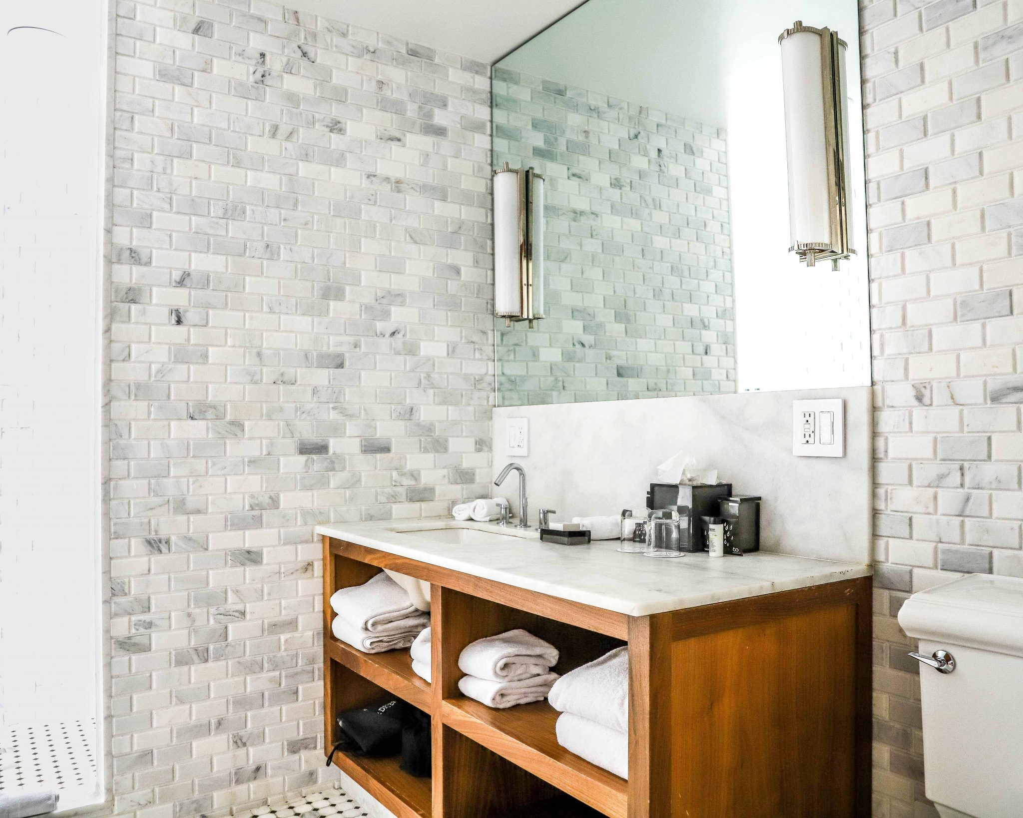 bathroom sink with cubby holes for towel storage and amenities