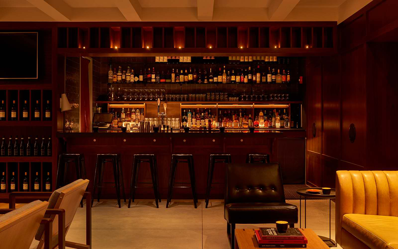 NoMad BARlo with full bar and seating area
