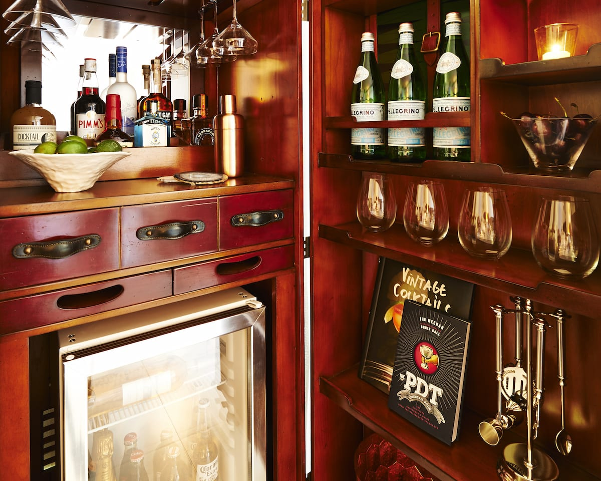 Close up of Nautilus minibar with fridge glasses sparkling water and liquor
