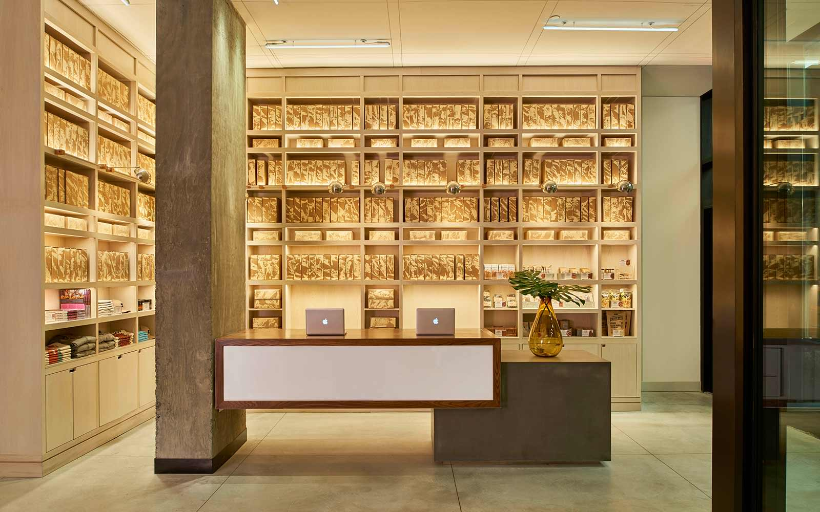 Arlo NoMad Lobby with wall shelves surrounding the modern front desk