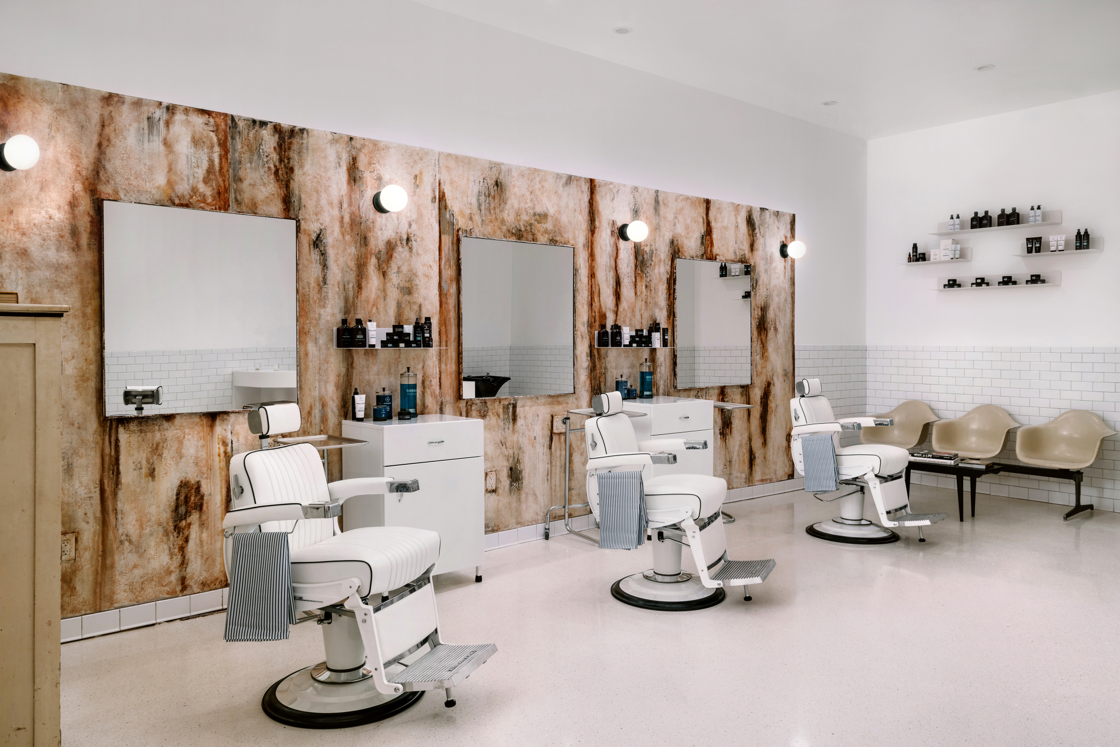 Interior of barber shop with wooden walls and clean white barber chairs