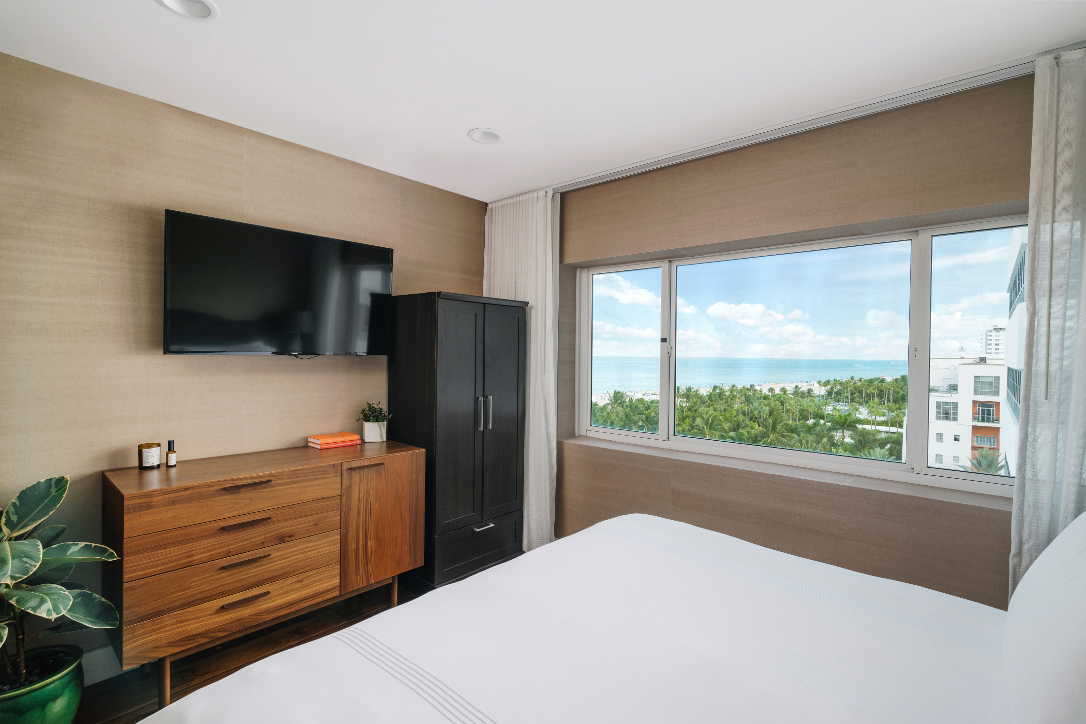 Window view of the ocean and treetops from the King bed