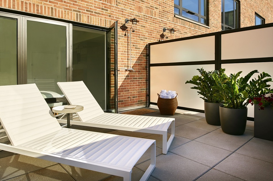 Outdoor terrace area of Arlo SoHo Twin Room with two lounge chairs