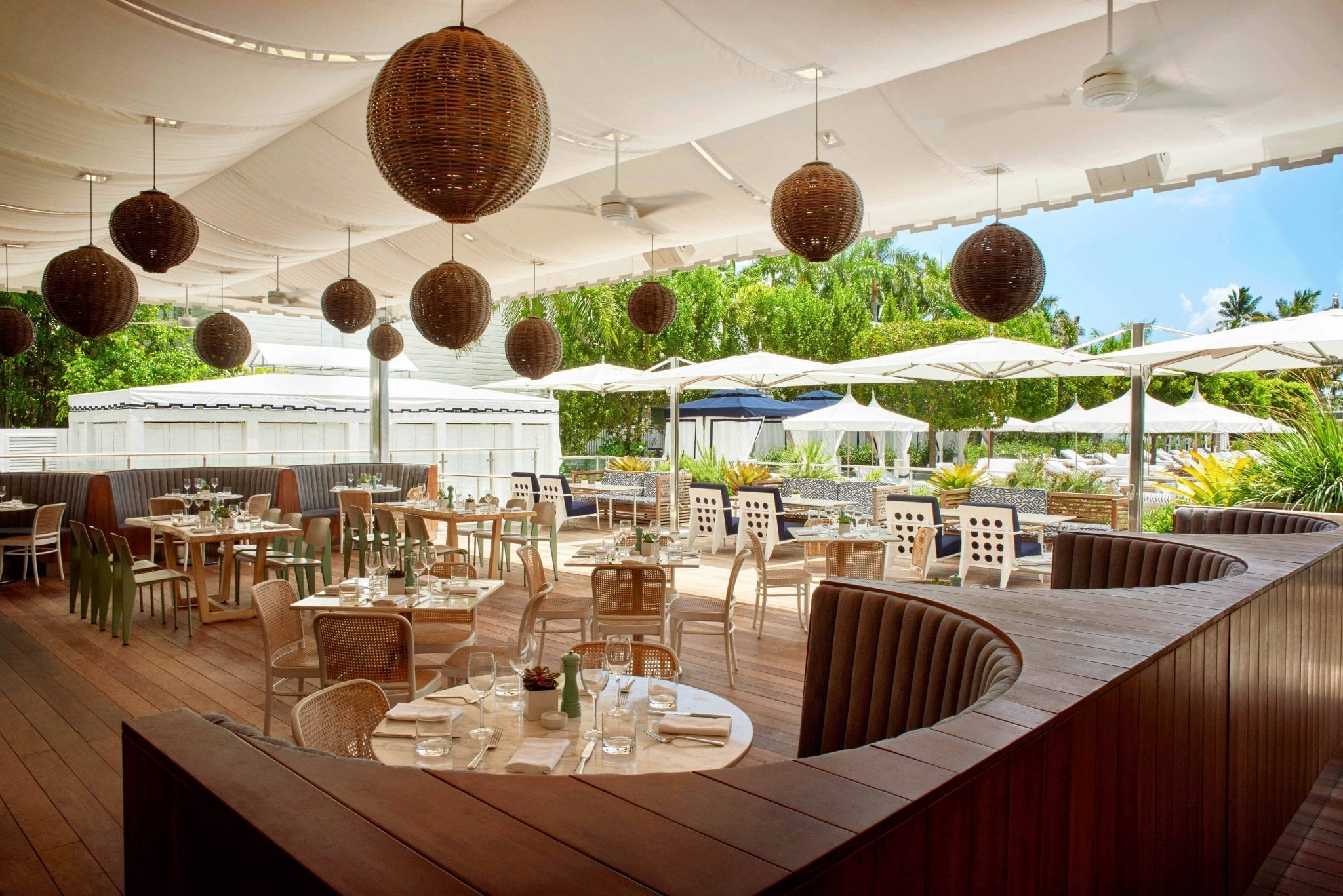 Outdoor restaurant areas with many tables and seats