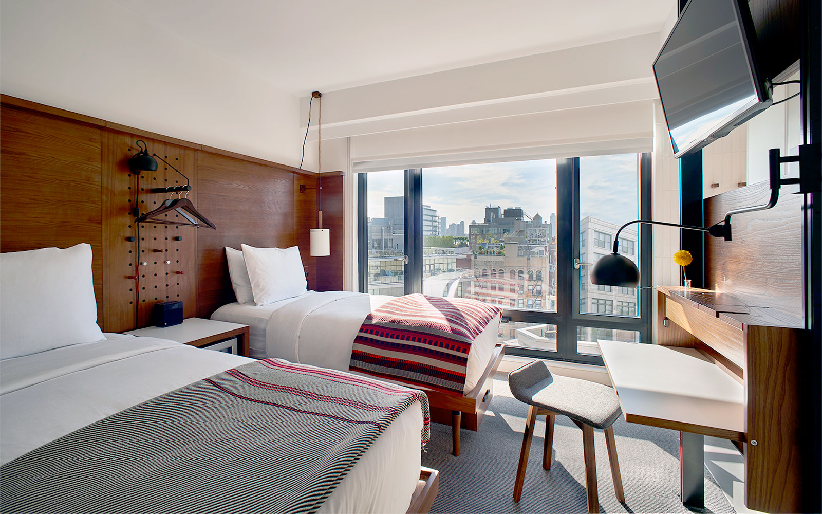 Arlo SoHo guest room two twin beds and large window with view