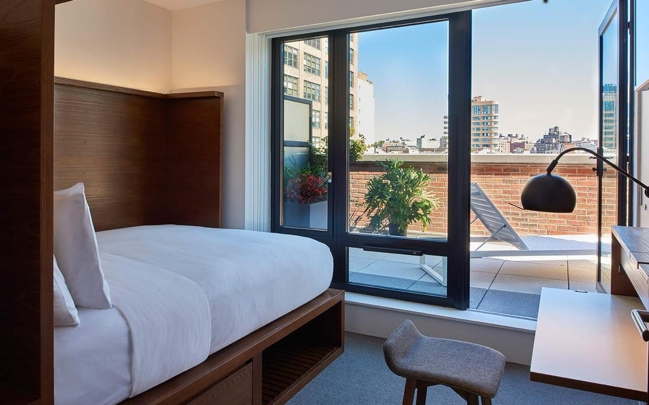 Arlo SoHo guest room with queen bed and terrace