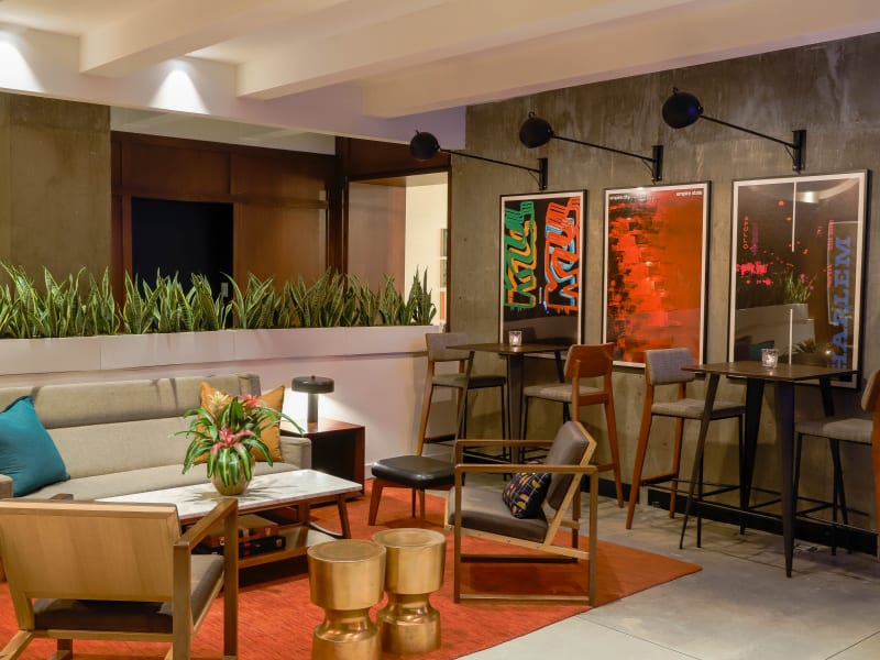 Arlo NoMad bar lounge space with multiple seating areas