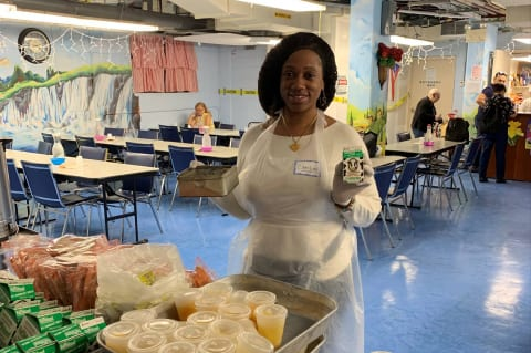 Caroline Gustave – Lobby Host volunteers her time to serve meals