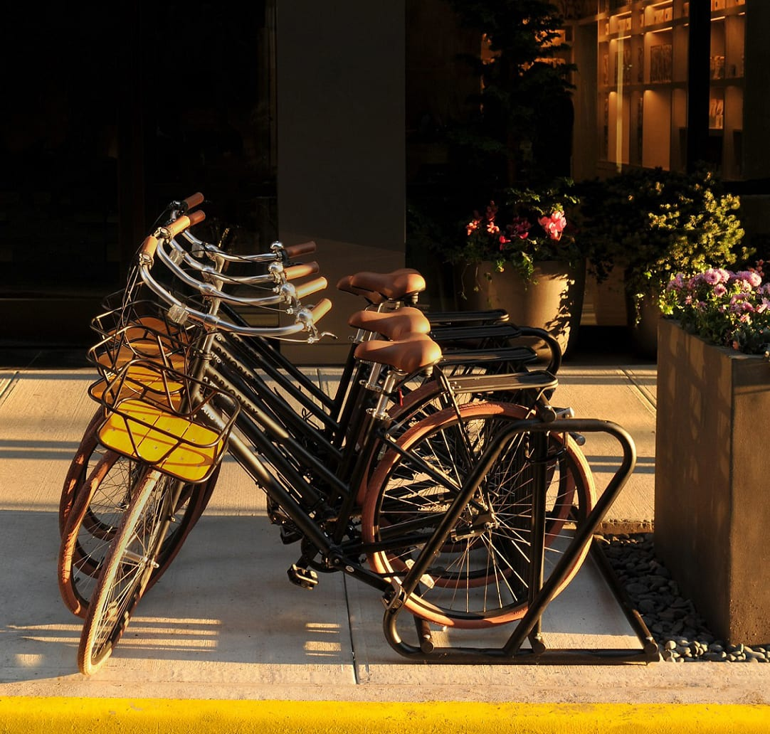 Four Arlo Midtown bikes on bike rack outdoors in front of the hotel