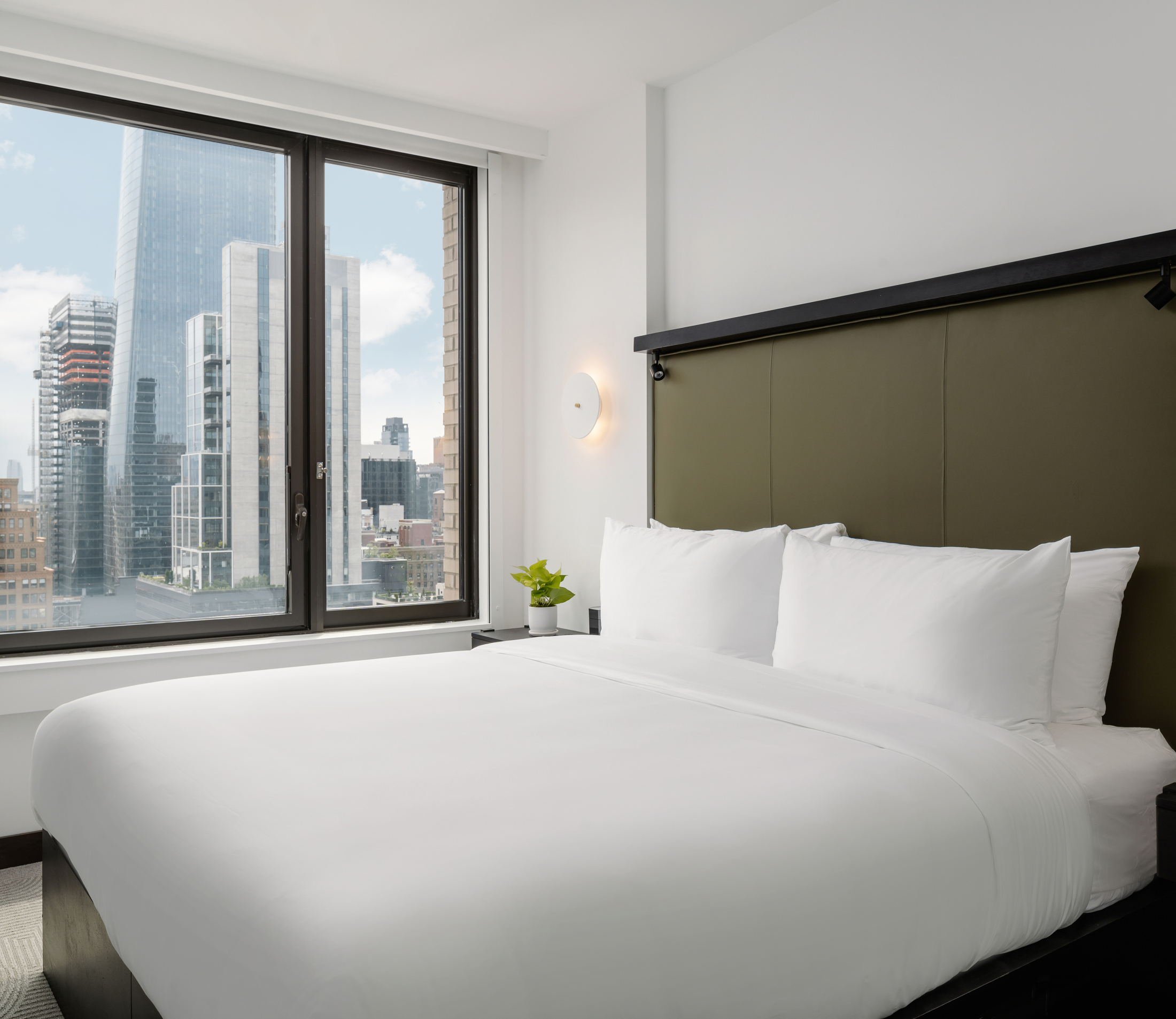 Arlo Midtown guestroom king bed with view of skyline